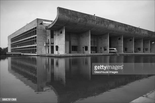 assembly building and reflecting pool, chandigarh, india - chandigarh stock pictures, royalty-free photos & images