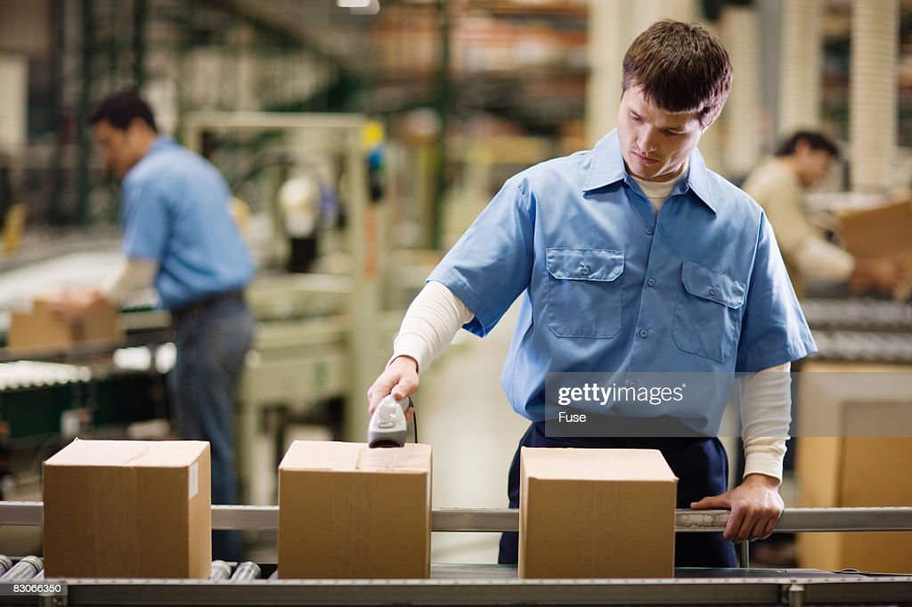Assembly Line Worker : Assembly line worker stock photo getty images