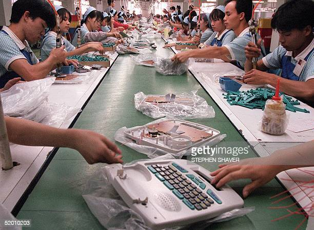 Assembly line workers at a Billion International Holdings' Hong Kong factory, based in Guangdong Province of China, assemble educational computers 13...
