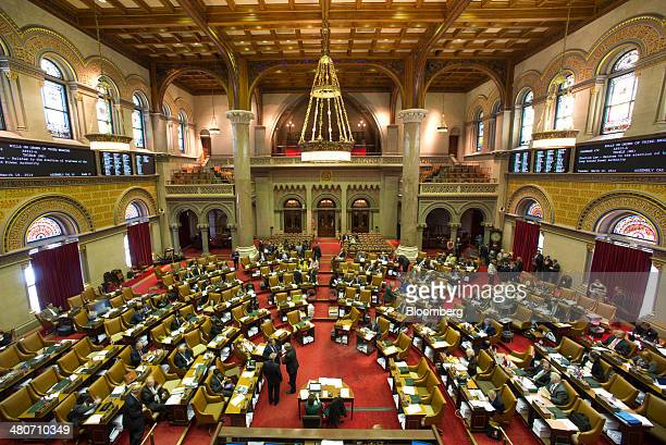 Assembly members sit inside the New York State Capitol building in Albany New York US on Wednesday March 19 2014 Budget talks among New York Governor...