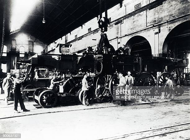 Assembly of one of the ten locomotives for the Romanian railway by the firm of Breda in Milan Italy 19th century Genoa Archivio Di Stato