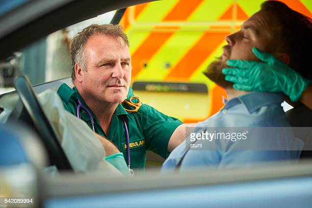 assessing the casualty - traffic accident stock photos and pictures