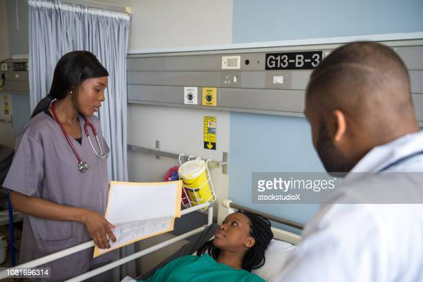 assessing the patient status - patient safety stock pictures, royalty-free photos & images