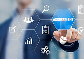 Assessment and analysis by professional auditing consultant concept, person touching screen with icons of risk evaluation, business analytics, quality compliance, process inspection, financial audit