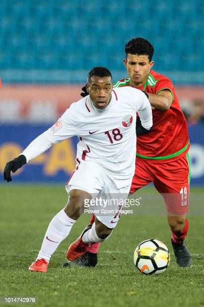Assim Madibo of Qatar fights for the ball with Zahir Al Aghbari of Oman during the AFC U23 Championship China 2018 Group A match between Oman and...
