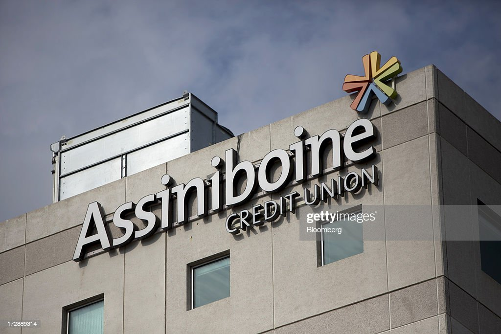 Assiniboine Credit Union headquarters stand in Winnipeg, Manitoba, Canada, on Thursday, July 4, 2013. Canada extended the longest streak of merchandise trade deficits in a quarter century in May, with the shortfall narrowing as imports fell faster than exports. Photographer: Brent Lewin/Bloomberg via Getty Images