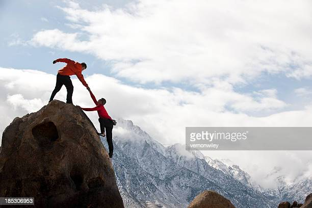 assist - mountaineering stock pictures, royalty-free photos & images