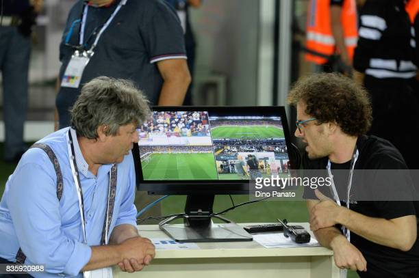 Assistan look the VAR during the Serie A match between Udinese Calcio and AC Chievo Verona at Friuli Stadium on August 20 2017 in Udine Italy