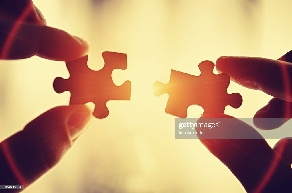 Assistance teamwork - puzzle connection : Stock Photo