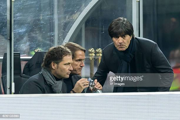 assistancecoach Marcus Sorg of Germany assistancecoach Thomas Schneider of Germany and coach Jochaim Loew of Germany looks on during the...