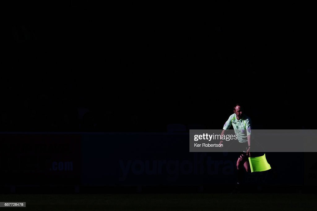 Assistand referee runs the line during the Sky Bet League One match between A.F.C. Wimbledon v Southend United at the Cherry Red Records Stadium on March 25, 2017 in Kingston upon Thames, United Kingdom.