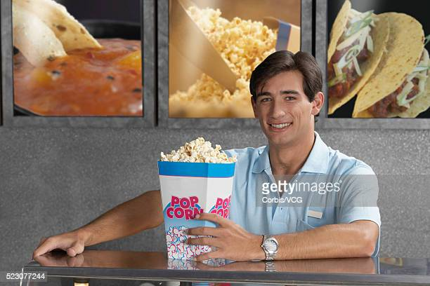 Assistant at Popcorn Counter at Movie Theater