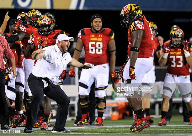 Assistant athletic director of football sport performance Rick Court of the Maryland Terrapins celebrates after the Terrapins' defense makes a stop...