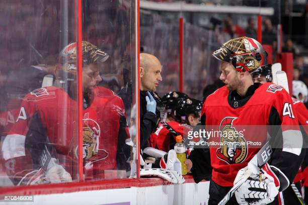 Assistant athletic therapist Domenic Nicoletta chats with Craig Anderson the Ottawa Senators about a puck that struck Anderson under his chin earlier...