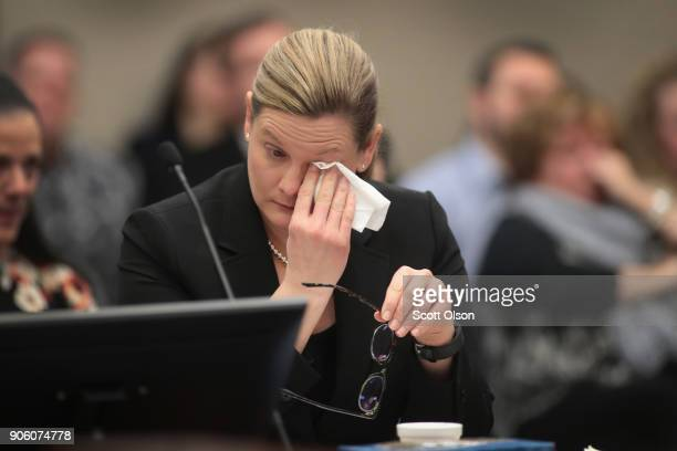 Assistant Attorney General Angela Povilaitis wipes a tear from her eye as she listens to Gwen Anderson deliver a victim impact statement at the...
