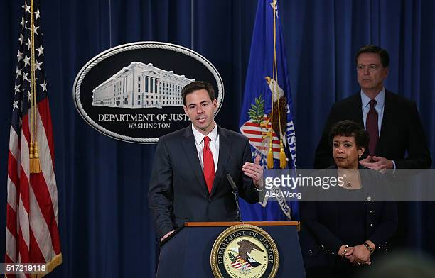 S Assistant Attorney General for National Security John Carlin speaks as Attorney General Loretta Lynch and FBI Director James Comey listen during a...