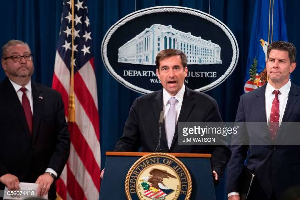 Assistant Attorney General for National Security John Demers speaks after Attorney General Jeff Sessions announced the creation of a new initiative...