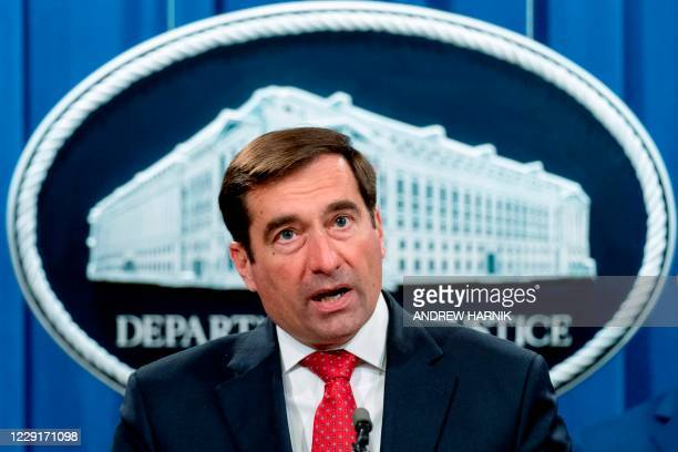 Assistant Attorney General for the National Security Division John Demers speaks at a news conference at the Department of Justice, October 19 in...