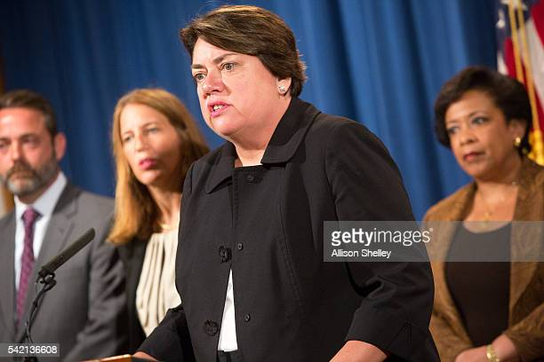 Assistant Attorney General Leslie R Caldwell speaks as she joins Attorney General Loretta Lynch right and other law enforcement officials to hold a...