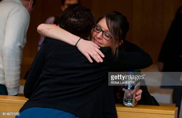 Assistant Attorney General Robyn Liddell hugs Nassar victim Ashley Erickson after the conclusion of the sentencing of former Michigan State...