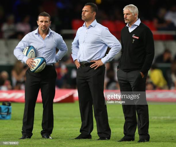 Assistant backs coaches Aaron Mauger and Tabai Matson and head coach Todd Blackadder look on before the Super Rugby match between The Sharks and...