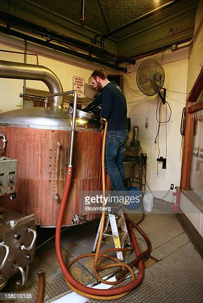 Assistant brewer Josh Willett cleans the boiler kettle at the Wynkoop Brewing Co in Denver Colorado US on Thursday Jan 26 2012 The Wynkoop Brewing Co...