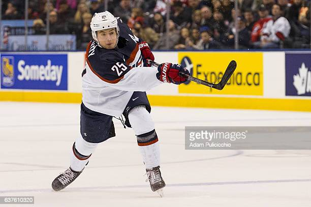 Assistant Captain defenseman Charlie McAvoy of Team United States takes a slapshot against Team Slovakia in a preliminary round - Group B game during...