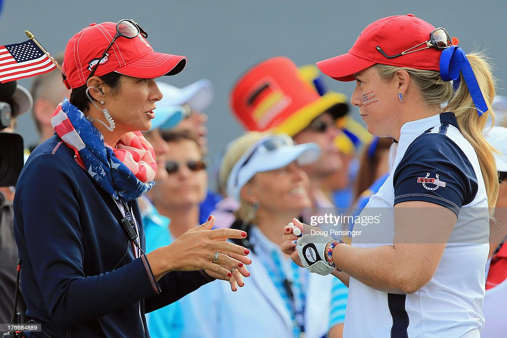 Assistant captain Laura Diaz talks with player Brittany Lincicome of the United States Team as they prepare to face the European Team during the morning foursomes matches at the 2013 Solheim Cup on August 17, 2013 at the Colorado Golf Club in Parker, Colorado.