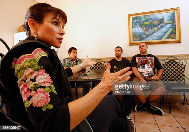 Assistant Chief Margarita Perez, left, and Deputy probation officer Paul Meza are visit clients Peter Azevedo left, and 42-year-old Eugene Molina at...