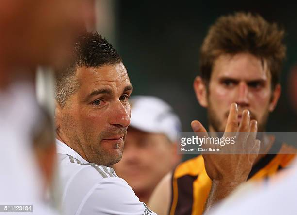 Assistant coach Adem Yze speaks to his players at the break during the 2016 AFL NAB Challenge match between the Hawthorn Hawks and the Carlton Blues...