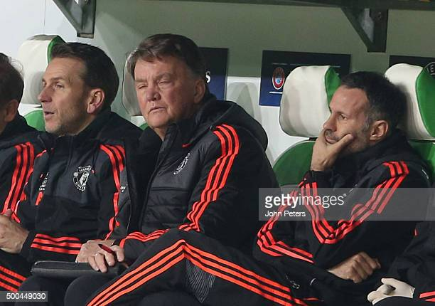 Assistant coach Albert Stuivenberg Manager Louis van Gaal and Assistant Manager Ryan Giggs of Manchester United watch from the bench during the UEFA...