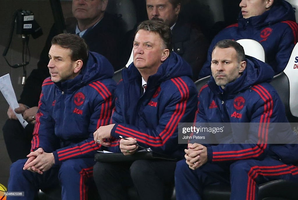 Assistant coach Albert Stuivenberg, Manager Louis van Gaal and Assistant Manager Ryan Giggs of Manchester United watch from the bench during the Barclays Premier League match between Newcastle United and Manchester United at St James' Park on 12 January 2016 in Newcastle Upon Tyne, England.