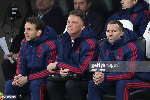 Assistant coach Albert Stuivenberg Manager Louis van Gaal and Assistant Manager Ryan Giggs of Manchester United watch from the bench during the...