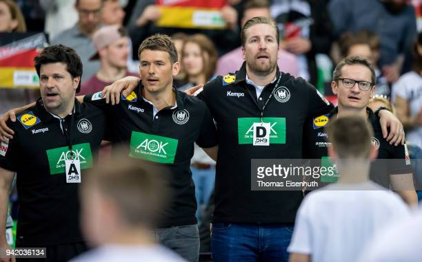 Assistant coach Alexander Haase coach Christian Prokop Team manager Oliver Roggisch and assistant coach Sven Raab of Germany during the national...