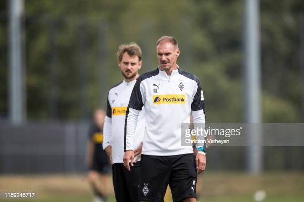 Assistant Coach Alexander Zickler and Assistant Coach Rene Maric are seen during a Borussia Moenchengladbach Training Session at BorussiaPark on...
