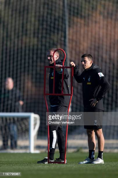 Assistant Coach Alexander Zickler and Stefan Lainer are seen during the Borussia Moenchengladbach Training Camp on January 09 2020 in Jerez de la...