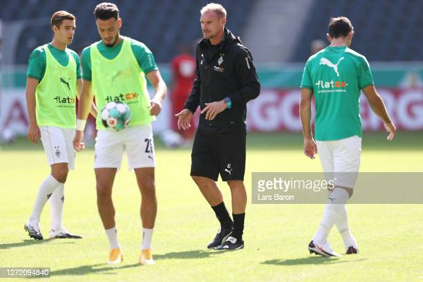 Assistant coach Alexander Zickler looks on prior to the DFB Cup first round match between FC Oberneuland and Borussia Mönchengladbach at...