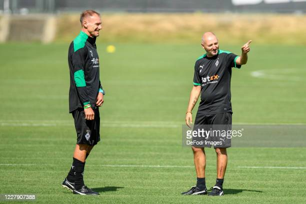 Assistant coach Alexander Zickler of Borussia Moenchengladbach and assistant coach Oliver Neuville of Borussia Moenchengladbach look on during the...