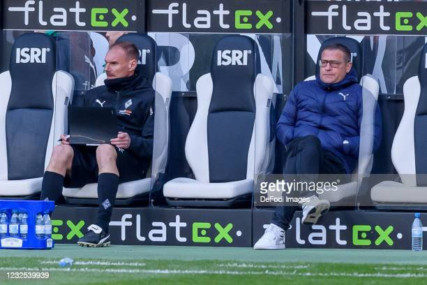 Assistant coach Alexander Zickler of Borussia Moenchengladbach and Sporting director Max Eberl of Borussia Moenchengladbach sits on the bench during...