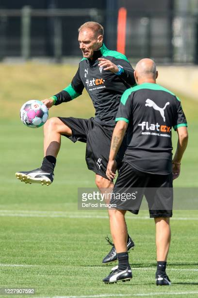 Assistant coach Alexander Zickler of Borussia Moenchengladbach controls the ball during the first training session after the summer break on August...