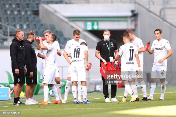 Assistant coach Alexander Zickler of Moenchengladbach talks to the players during a drinking break during the DFB Cup first round match between FC...