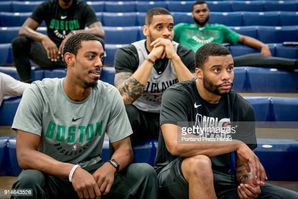 Assistant coach Allen Harris guard Josh Adeyeye and guard Jerome Seagears watch film with their fellow Maine Red Claws teammates courtside at...