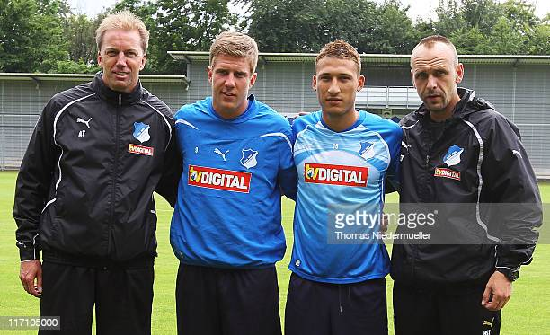 Assistant coach Andre Trulsen Sven Schipplock Fabian Johnson and head coach Holger Stanislawski pose for the media during a training session at the...