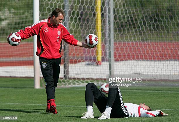 Assistant coach Andreas Koepke talks to Jens Lehmann during the German National Team training session at the AdidasStadium on May 30 2007 in...