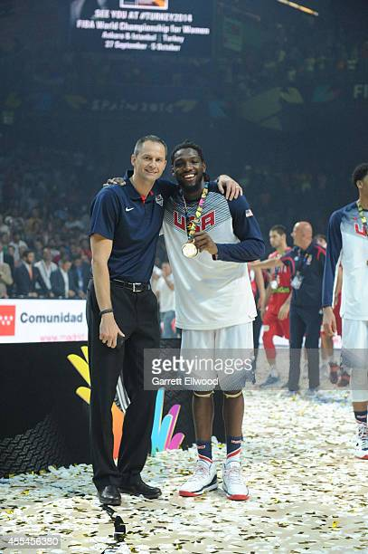 Assistant Coach Arturas Karnisovas and Kenneth Faried of the USA Men's National Team poses for a photo with the gold medals after defeating the...