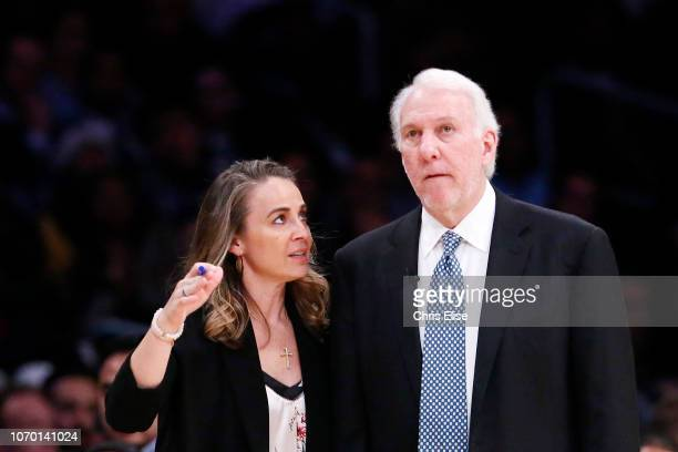 Assistant Coach Becky Hammon is seen talking to Head Coach Gregg Popovich of the San Antonio Spurs during a game against the Los Angeles Lakers on...