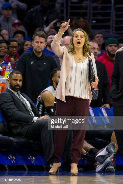 Assistant coach Becky Hammon of the San Antonio Spurs calls out to her team against the Philadelphia 76ers at the Wells Fargo Center on January 23...