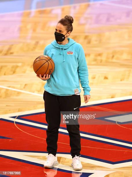 Assistant coach Becky Hammon of the San Antonio Spurs directs her team during warm ups before the game against the Brooklyn Nets at Barclays Center...
