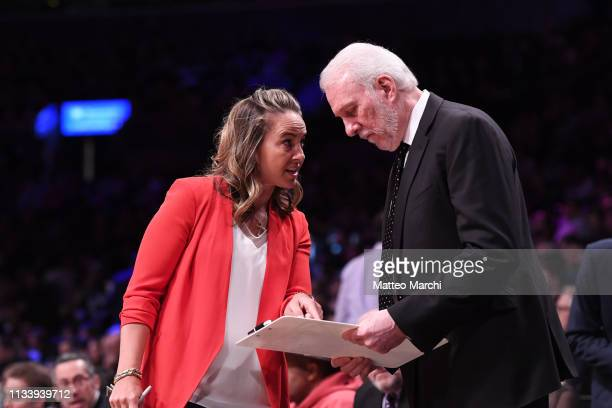 Assistant coach Becky Hammon with Gregg Popovich of the San Antonio Spurs during the game against the Brooklyn Nets at Barclays Center on February 25...