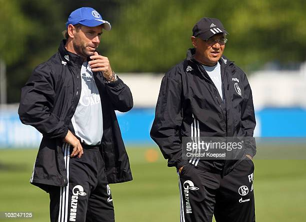 Assistant coach Bernd Hollerbach of Schalke and head coach Felix Magath attend the FC Schalke training session at the training ground on August 5,...
